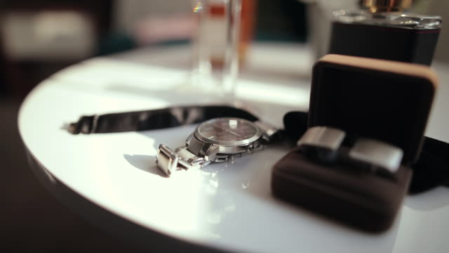 close up of wristwatch, cuff links and bow tie on white round table - fashion collection stock videos & royalty-free footage