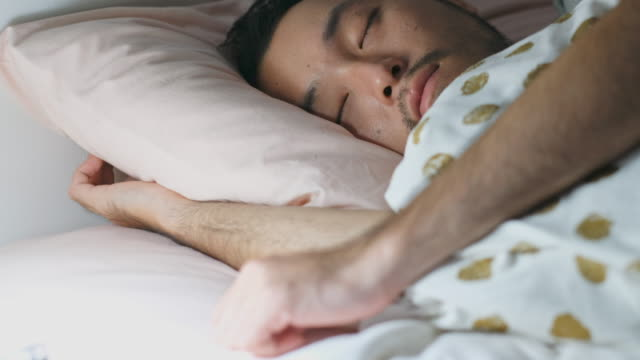 close up of  young asian man deep sleeping with comfortable in bed - blanket stock videos & royalty-free footage