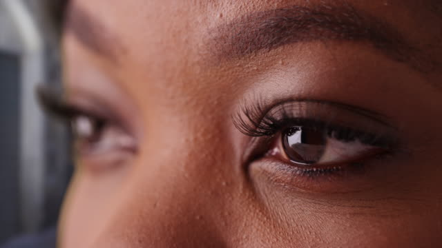 close up of young black woman's eyes blinking - african american ethnicity stock videos & royalty-free footage