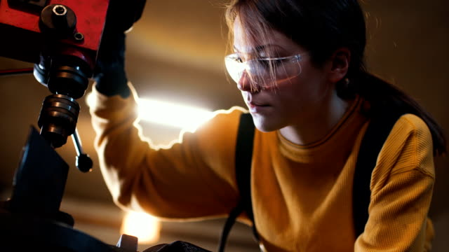 Close up of young female welder