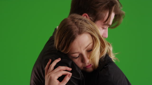 close up of young male and female caught in tender embrace on green screen - plain background stock videos & royalty-free footage