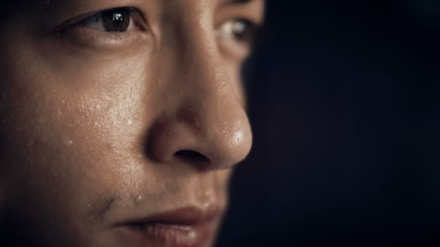 close up of young man sweating - determinazione video stock e b–roll