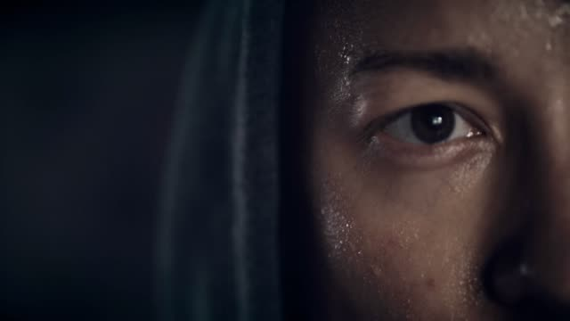 close up of young man's face sweating - sweat stock videos & royalty-free footage