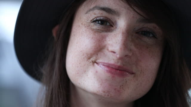 close up of young woman with freckels - amicizia tra donne video stock e b–roll