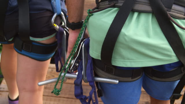 close up of zipline equipment hanging off the side of harness - turtle bay hawaii stock videos and b-roll footage