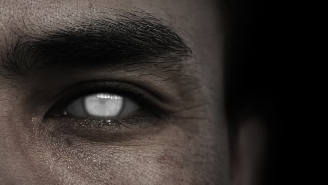 close up of zombie white eyes with black background - devil stock videos & royalty-free footage