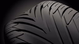 Close up on a car tire in motion.