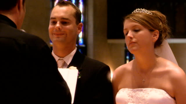 close up on a couple during thier wedding ceremony - pastor stock videos & royalty-free footage
