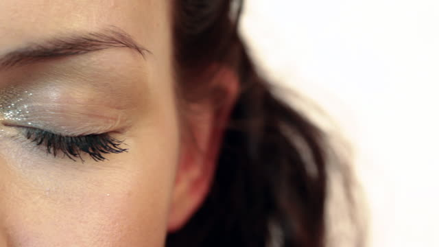 close up on eye of beautiful young woman - sideways glance stock videos & royalty-free footage
