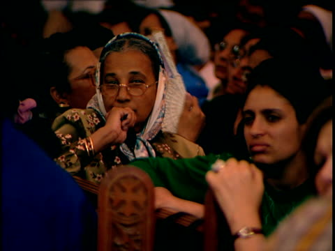 close up on faces of coptic orthodox christians in st mark's cathedral listening to pope shenouda iii preaching the cathedral is in the abbassiya... - financial item stock videos & royalty-free footage