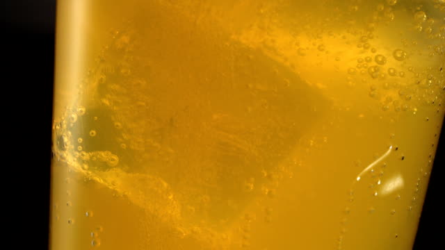 close up on glass full of yellow carbonated drink - fizzy lemonade stock videos & royalty-free footage