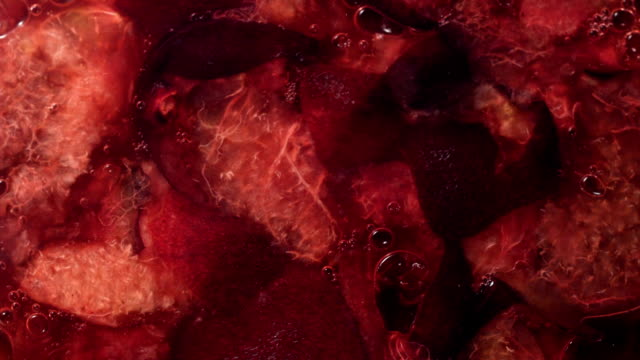 close up on mashed plums. cointainer filling with plum's juice - preserve stock videos and b-roll footage
