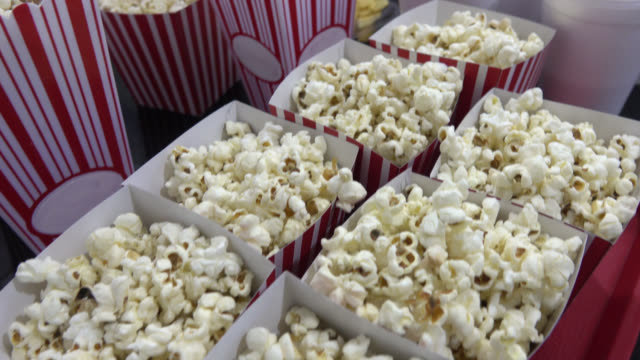 Close up on pop corn and sodas at the cinema