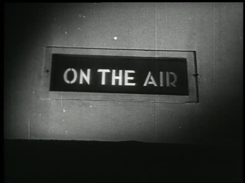 "B/W 1938 close up ""On the Air"" sign in radio studio"