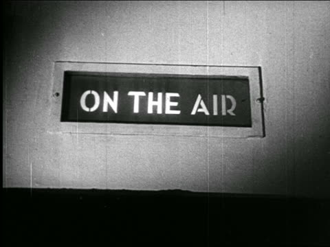 "b/w 1938 close up ""on the air"" sign lit up in radio studio / newsreel - radio studio stock videos & royalty-free footage"