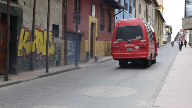close up on the cars on eye level showing a red mini bus for public transport and a taxi. - the cars stock videos & royalty-free footage