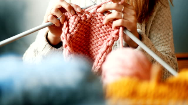 close up on woman's hands knitting - craft stock videos & royalty-free footage