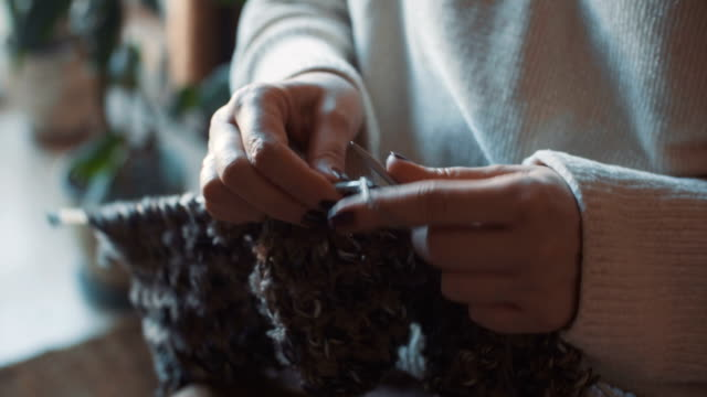 close up on woman's hands knitting - home made stock videos & royalty-free footage