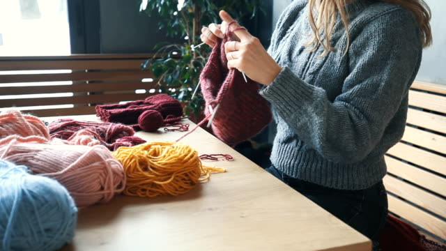close up on woman's hands knitting - scarf stock videos & royalty-free footage