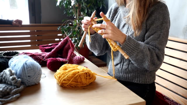 close up on woman's hands knitting - knitting needle stock videos & royalty-free footage