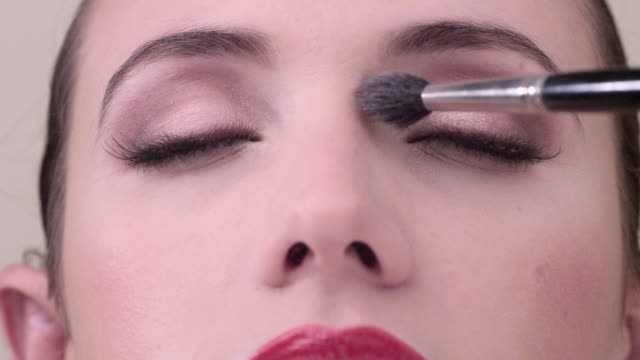 ecu close up on young woman face as shes being made up - extreme close up stock videos & royalty-free footage