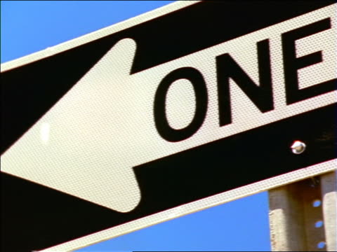 """close up pan """"one way"""" sign / new mexico - one way stock videos and b-roll footage"""
