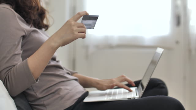 Close up online shopping with credit card at home