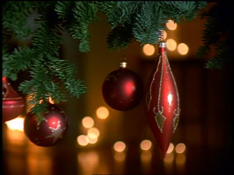 close up pan ornaments hanging on christmas tree - einige gegenstände mittelgroße ansammlung stock-videos und b-roll-filmmaterial