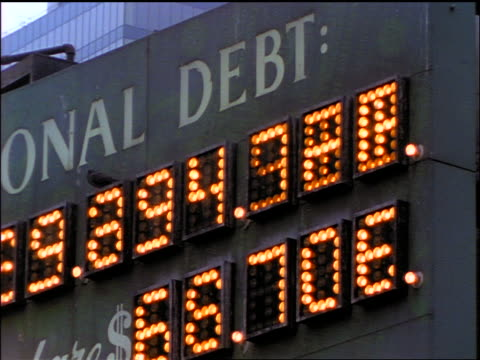 close up pan our national debt sign / new york city - debt stock videos & royalty-free footage