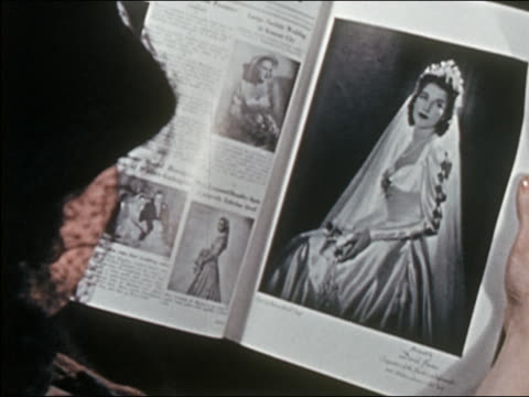 """1941 close up over the shoulder view of woman reading ""The Bride's Magazine"""""