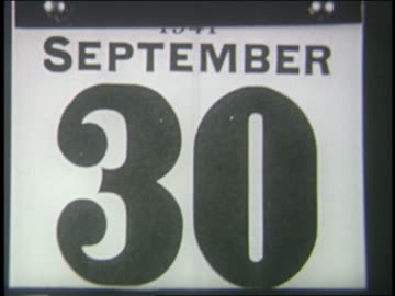 vidéos et rushes de b/w 1941 close up pages of daily calendar peeling off - 1941