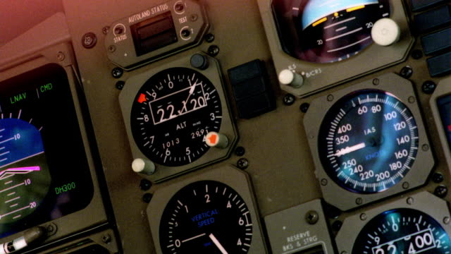 close up pan airplane cockpit control panel - pannello di controllo video stock e b–roll