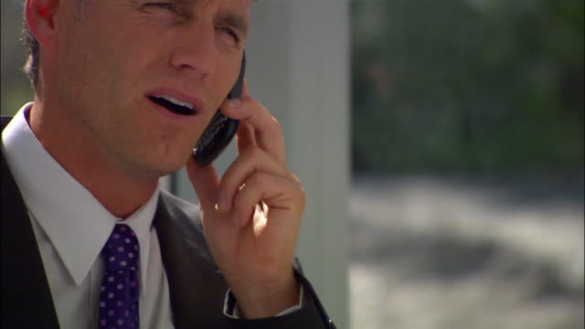 stockvideo's en b-roll-footage met close up pan businessman on phone near window/ seattle - 2007