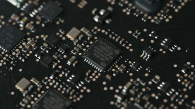 Close up pan circuitry and chips are seen inside a stripped Apple Inc MacBook Pro laptop computer in an arranged video shot in Bangkok Thailand on...