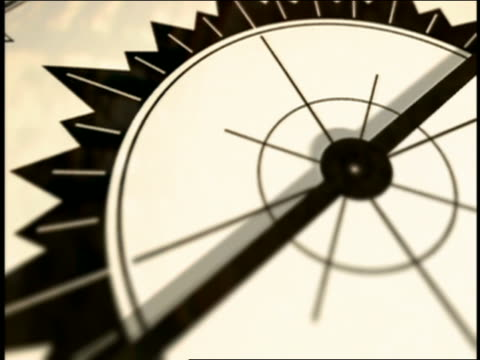 close up pan hand on compass pointing to north - kompass stock-videos und b-roll-filmmaterial