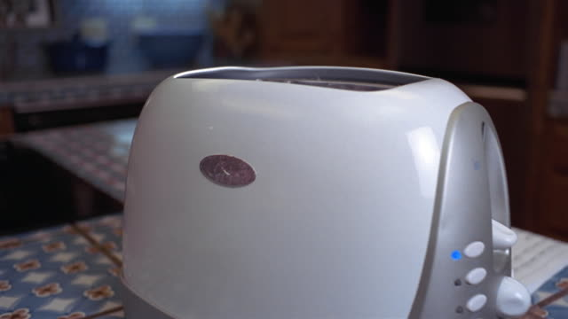 close up pan in to one slice of burnt toast popping out of toaster - toaster appliance stock videos & royalty-free footage