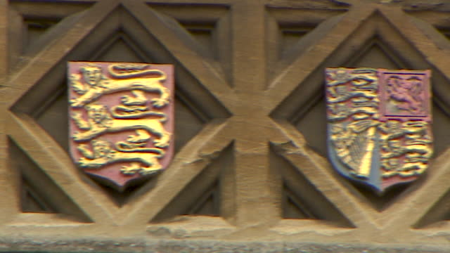 close up pan right then left of a row of coat of arms on the brickwork of oriel college, oxford - 20 24 years stock videos & royalty-free footage