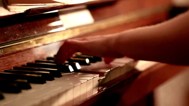 close up pan shot of woman playing piano - musical symbol stock videos & royalty-free footage