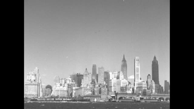 Close up Pan skyline of lower Manhattan looking north from Governor's Island in daytime including tallest buildings from left to right 40 Wall Street...