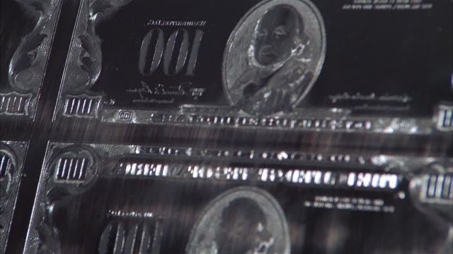close up pan tilt down plate for printing sheet of us$100 bills - 1984 stock videos & royalty-free footage