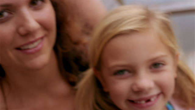 close up pan tilt up smiling faces of family - clarkesville stock videos & royalty-free footage