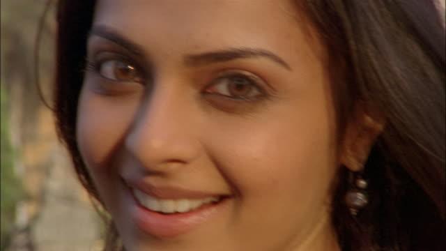 Close up pan woman smiling at camera