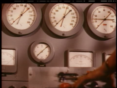1951 close up panel of gauges in chevrolet factory - 測定器点の映像素材/bロール