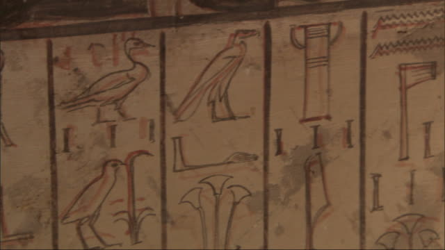 Close Up, pan-left - A mural depicts Egyptian figures and hieroglyphics