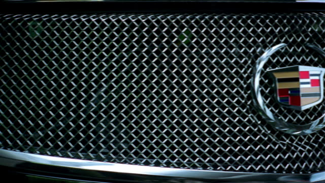 close up panning cadillac logo on grill of car - logo stock videos and b-roll footage