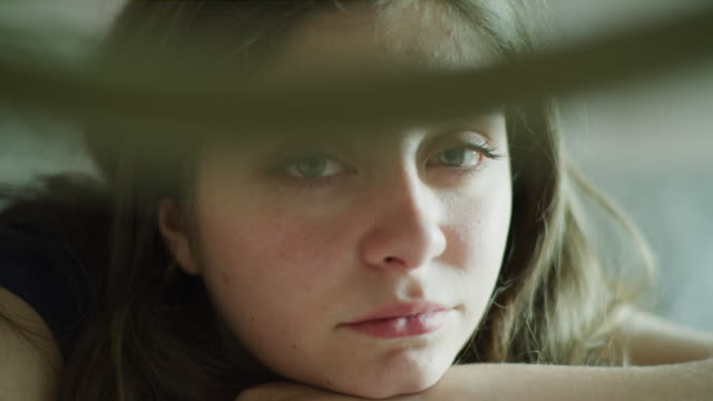 close up panning shot of face of serious girl / cedar hills, utah, united states - tristezza video stock e b–roll