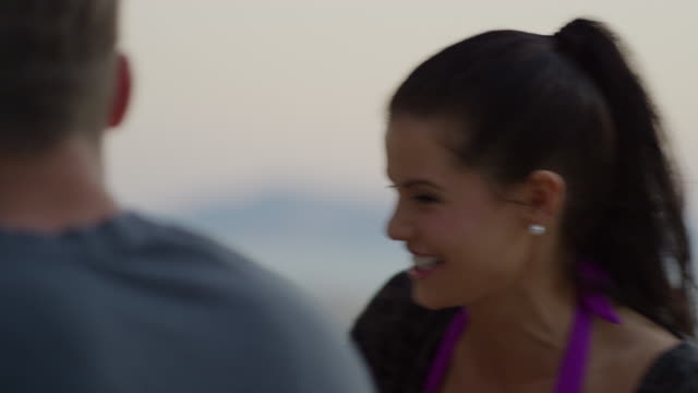Close up panning shot of friends talking and laughing / Cedar Hills, Utah, United States