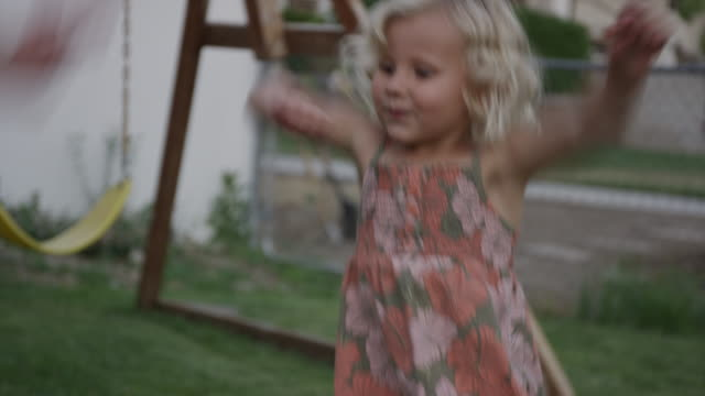 vídeos de stock e filmes b-roll de close up panning shot of girl dancing near swing set / orem, utah, united states - orem