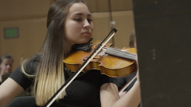 close up panning shot of high school girl playing violin on stage / salt lake city, utah, united states - female high school student stock videos & royalty-free footage
