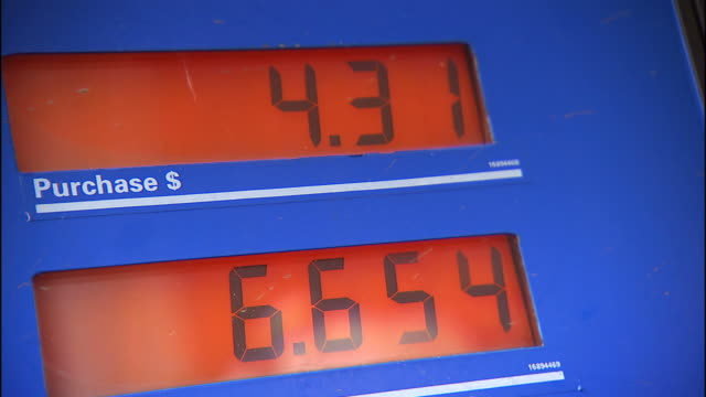 Close Up pan,right , Digital windows display the number of gallons of fuel and the price of fuel at a gas station. / Puerto Rico